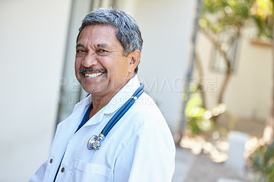 Buy stock photo Cropped portrait of a male doctor smiling happily outside