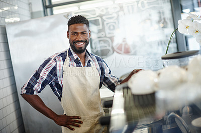 Buy stock photo Cropped portrait of a handsome male barista working in a coffee shop
