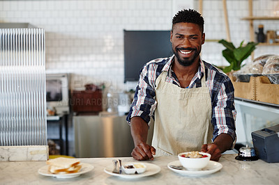 Buy stock photo Cropped portrait of a handsome young man working in a cafe
