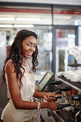 Buy stock photo Portrait of a young female barista standing by an espresso machine