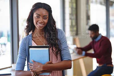 Buy stock photo A portrait of an attractive woman using a digital tablet at a coffee shop