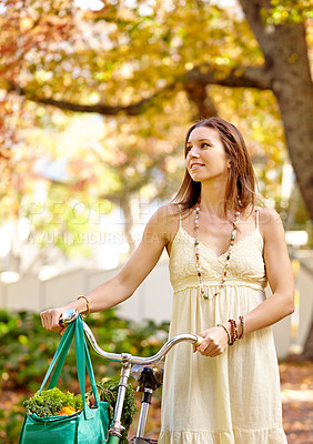 Buy stock photo Shot of an attractive young woman in the park on an autumn day