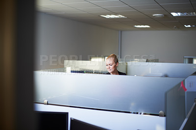 Buy stock photo Cropped shot of an attractive young woman standing in her office cubicle