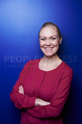 Buy stock photo Cropped portrait of a blonde woman standing in the studio