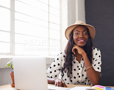 Buy stock photo Portrait of a young designer working on her laptop
