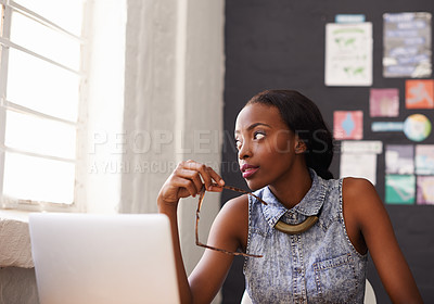 Buy stock photo Shot of a beautiful woman sitting behind her laptop