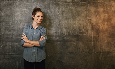 Buy stock photo Cropped shot of an attractive young woman standing against a grunge background