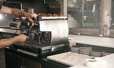 Buy stock photo Cropped shot of a male barista making a cup of coffee