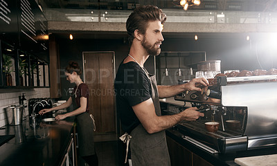 Buy stock photo Cropped shot of a handsome male barista making a cup of coffee