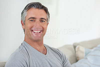 Buy stock photo Portrait of a handsome mature man relaxing at home