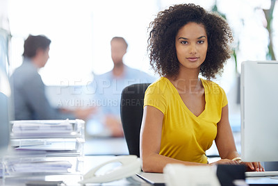 Buy stock photo Cropped portrait of an attractive young businesswoman sitting at her desk at the office