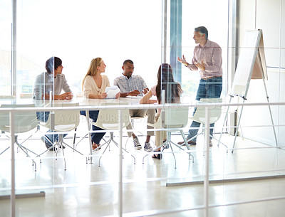 Buy stock photo Full length shot of a group of business colleagues in a boardroom meeting