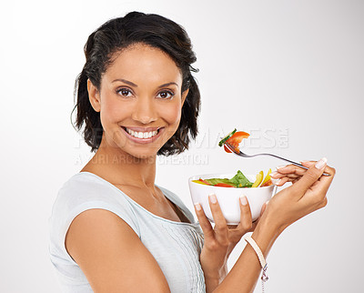 Buy stock photo Portrait of a young woman enjoying a salad