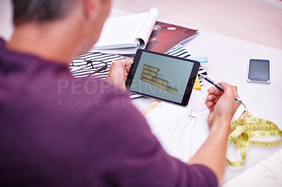 Buy stock photo Cropped shot of a handsome designer at work in his office