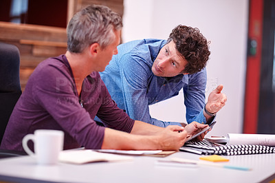 Buy stock photo Cropped shot of two male coworkers at work