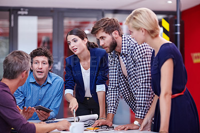 Buy stock photo Cropped shot of creative professionals brainstorming during a meeting