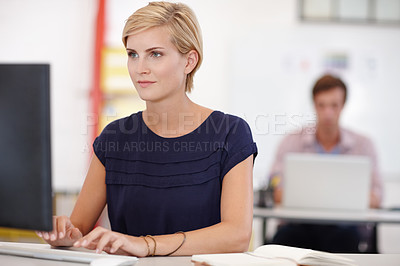 Buy stock photo Cropped shot an attractive young businesswoman working on her laptop