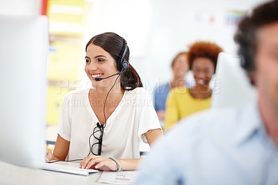 Buy stock photo Cropped shot of an attractive young call center operator in the office