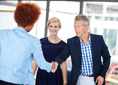 Buy stock photo A mature business manager shaking hands with an employee