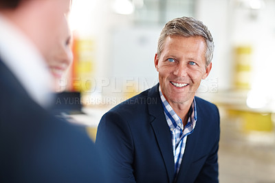 Buy stock photo Cropped shot of a mature businessman talking to his colleagues in the office