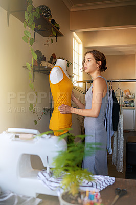 Buy stock photo A young designer making a garment in her workplace