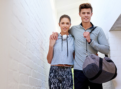 Buy stock photo Shot of a sporty young couple on their way to the gym together