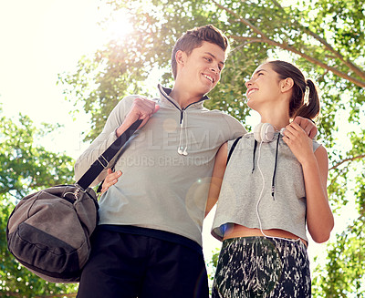 Buy stock photo Shot of a sporty young couple walking together before a workout