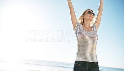 Buy stock photo Cropped shot of an attractive young woman on the beach