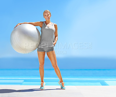 Buy stock photo Portrait of a beautiful young woman standing by a pool holding an exercise ball