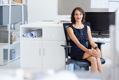 Buy stock photo Portrait of a young designer sitting at her workstation in an office