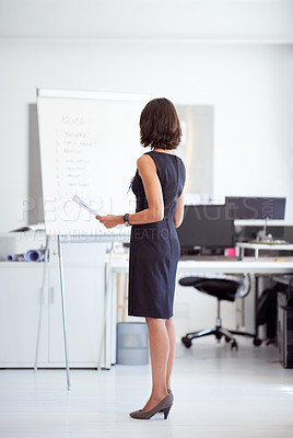 Buy stock photo Shot of a businesswoman at standing in an office