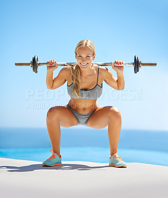 Buy stock photo Full length portrait of an attractive young woman doing squats with a barbell outside