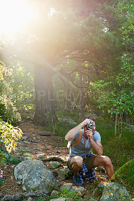 Buy stock photo Shot of a handsome man taking pictures of the scenery around him