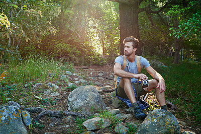 Buy stock photo Shot of a hiker holding his camera