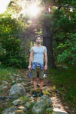 Buy stock photo Shot of a young outdoorsman on a hike