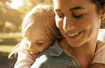 Buy stock photo Shot of a loving mother and daughter at the park