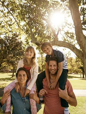 Buy stock photo Portrait of a family of four enjoying a day at the park