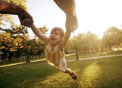 Buy stock photo Shot of a little girl being swung through the air