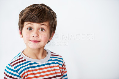 Buy stock photo Shot of a cute little boy looking at the camera