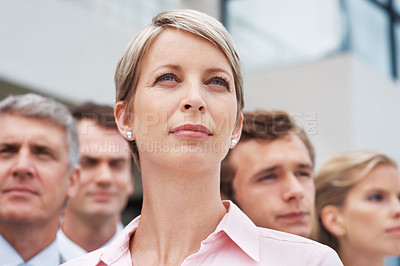 Buy stock photo Portrait of a team of confident business people looking away