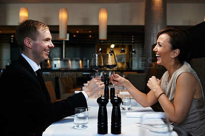 Buy stock photo Cropped shot of a couple having dinner in a restaurant