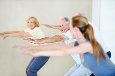Buy stock photo A group of elderly people stretching together in a class