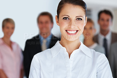 Buy stock photo Portrait of smiling young businesswoman leading her team at office