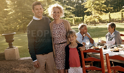 Buy stock photo Shot of a family spending time together while having lunch outdoors