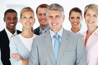 Buy stock photo Portrait of midddle aged businessman leading his team at office