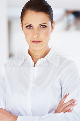 Buy stock photo Portrait of a smart young businesswoman standing with folded hand at office