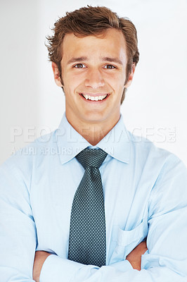 Buy stock photo Portrait of a smiling young businessman with his hands folded