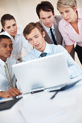 Buy stock photo Group of businesspeople together working on laptop on some business project at office