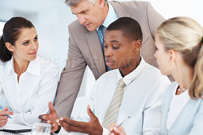 Buy stock photo African american businessman in meeting with colleagues discussing working ideas