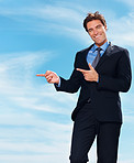 Young business man showing something imaginary on cloudy sky